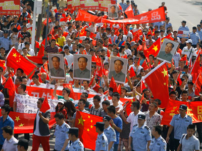 hinese demonstrators carry anti-Japan banners and shout slogans during a protest over the Diaoyu islands issue, known as the Senkaku islands in Japan, in Wuhan.(AFP Photo /  China Out)