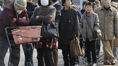 People queue for supplies outside a shop in Fukushima on March 13, 2011 (AFP Photo / Philippe Lopez)