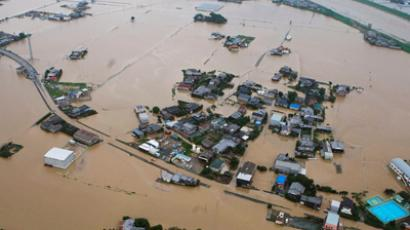 An aerial view shows flooded residential area after a bank of the Yabegawa river collapsed caused by heavy rains in Yanagawa, Fukuoka prefecture, Kyodo July 14, 2012 (Reuters / Kyodo)