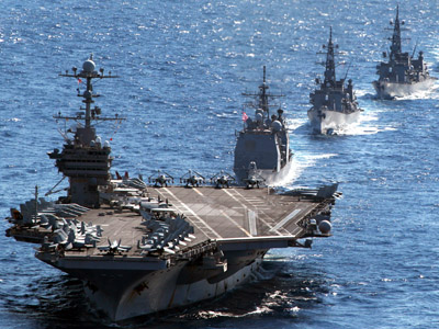 US aircraft carrier USS George Washington leads a US guided missile cruiser and three Japanese destroyers during the Keen Sword US-Japan military exercises in the Pacific Ocean on December 10, 2010. (AFP Photo/Shigeki Miyajima)
