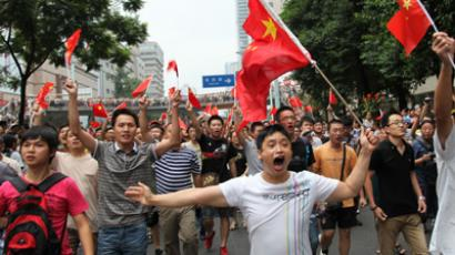 Chinese protesters waving the country's flag as they take part in a demonstration in Chengdu against Japan's claim of the disputed islands (AFP Photo / China out)
