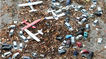 Light planes and vehicles sit among the debris after they were swept by a tsumani that struck Sendai airport in northern Japan on Friday March 11, 2011
