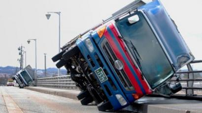 Two trucks lie on their sides on a bridge at Toyama city, western Japan on April 3, 2012 (AFP Photo / JiJi Press)