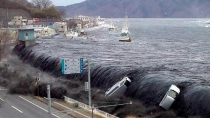 This picture taken by a Miyako City official on March 11, 2011 and released on March 18, 2011 shows a tsunami breeching an embankment and flowing into the city of Miyako in Iwate prefecture shortly after a 9.0 magnitude earthquake hit the region of northern Japan (AFP Photo / Jiji Press)