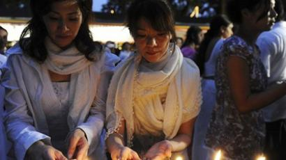 Japanese Buddhist devotees offer prayers during a Buddhist ritual to invoke blessings on the earthquake and tsunami's victims in Japan at the official Presidential Residence in Colombo on March 27, 2011