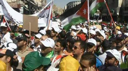 "Thousands march in the Jordanian capital of Amman to call for ""real"" political reforms. October 5, 2012 (Still from AP video)"