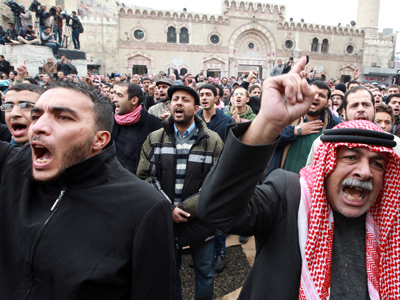 Protesters from the Islamic Action Front and other opposition parties shout slogans during a demonstration against rising fuel prices after Friday prayers in Amman November 23, 2012 (Reuters / Muhammad Hamed)