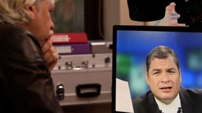 Julian Assange speaks with President Rafael Correa of Ecuador