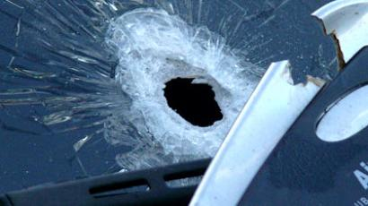 Gunshot through car's windscreen