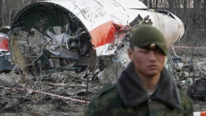 A Russian serviceman standing guard near part of the wreckage of a Polish government TU-154 Tupolev aircraft that crashed near Smolensk airport in this April 11, 2010