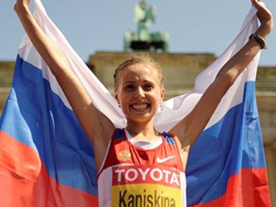 Olga Kaniskina celebrates (AFP Photo / Oliver Lang)