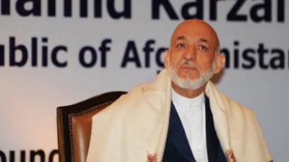 Afghanistan President Hamid Karzai looks on before speaking at the RK Mishra Memorial lecture in New Delhi on October 5, 2011 (AFP Photo / Raveendran)