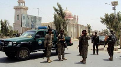 Afghan security forces stand guard in front of a mosque in the southern city of Kandahar province on July 14, 2011 (AFP Photo / Mamoon Durrani)