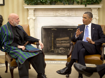 U.S. President Barack Obama meets with Afghanistan's President Hamid Karzai in the Oval Office of the White House in Washington, January 11, 2013. (Reuters/Jason Reed)