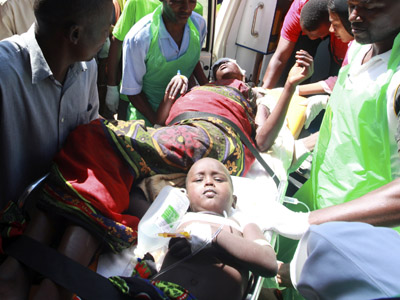 Paramedics at the Malindi district hospital assist people, injured when their community members were attacked in Tana River district in the Tana Delta region December 21, 2012. (Reuters/Joseph Okanga)