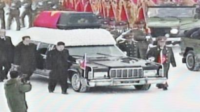 North Korea's Kim Jong-Un (center L) walking besides the convoy carrying the body of his father and late leader Kim Jong-Il at Kumsusan Memorial Palace in Pyongyang (AFP Photo / North Korean TV)