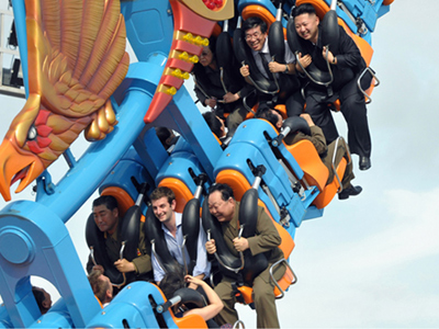 Kim Jong-un enjoying a ride at the Rungna People's Pleasure Ground in Pyongyang (AFP Photo / KCNA via KNS)