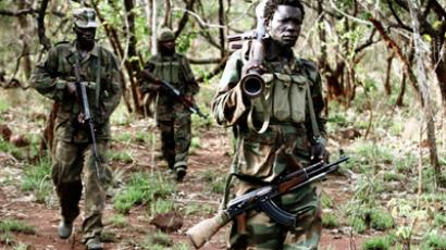 Ugandan soldiers, who are tracking down LRA fugitive leaders, walk at a forest near river Chinko (Reuters / Stringer)