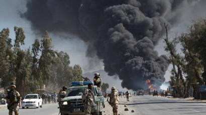 Gunfire wounded at least 26 people during fresh protests in several cities across Afghanistan over the burning of copies of the Koran, Islam's holy book, at NATO's main base in Afghanistan. (REUTERS/Parwiz )