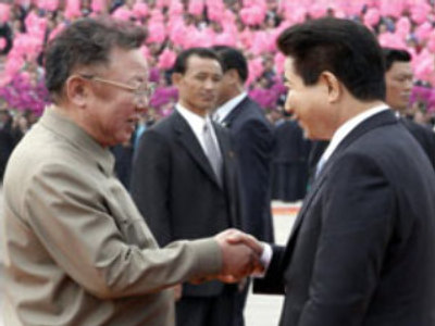 Kim Jong Il, as North Korean leader, shakes hands with Roh Moo-hyun, as South Korea President