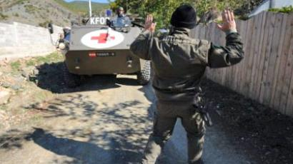 KFOR soldiers patrol near the village of Cabra on October 18, 2011 as NATO confronted Serbs manning a roadblock in northern Kosovo but agreed to wait 24 hours for a compromise that will allow its KFOR force to supply troops in the sensitive area (AFP Photo / Armend Nimani)