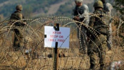 Kosovo Force KFOR soldiers guard the border crossing Jarinje between Serbia and northern Kosovo (AFP Photo / Dimitar Dilkoff)