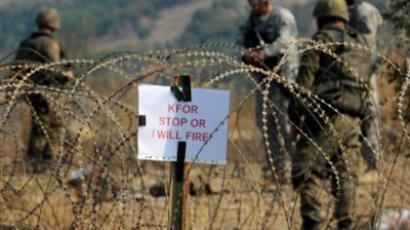 Kosovo Force KFOR soldiers guard the border crossing Jarinje between Serbia and northern Kosovo on September 16, 2011 (AFP Photo / Dimitar Dilkoff)