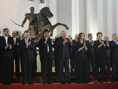 Ecuador's President Rafael Correa, Colombia's President Juan Manuel Santos, Bolivia's President Evo Morales, Venezuela's President Hugo Chavez, Argentina's President Cristina Kirchner, Brazilian President Dilma Rousseff and Cuban President Raul Castro (From Lto R, first row) pose for the family picture of the Community of Latin American and Caribbean States (CELAC) summit on December 2, 2011 in Caracas (AFP Photo / LEO RAMIREZ)
