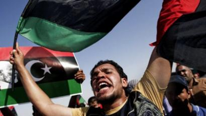 Tens of thousands of Libyans attend a mass rally hoping to bolster rebel moral in the rebel stronghold of Benghazi and send a message to Tripoli, on July 6, 2011 (AFP Photo / Gianluigi Guercia)