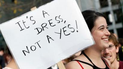 A woman holds up a sign during a SlutWalk rally against sexual abuse and inequality in Brussels(Reuters/Sebastien Pirlet)