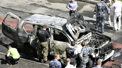 Russian investigators work near the scene of a car bomb blast in the city of Kazan (Reuters)