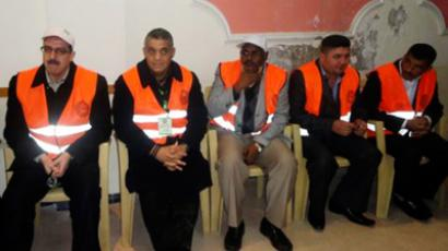 Arab League observers are pictured during a visit to Zabadani, near Damasus, January 21, 2012 (Reuters / Handout)