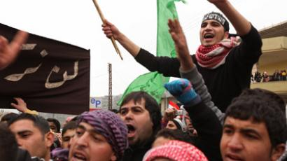 Demonstrators shout slogans against the Syrian regime during a protest following the Friday prayers in Wadi Khaled on the Lebanese-Syrian border on December 30, 2011. (AFP Photo/Si Mitchell)