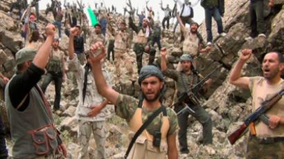 "Free Syrian Army fighters shout ""Allahu Akbar"" near Deraa in this still image taken from a video obtained by Reuters May 17, 2012 (Reuters/Handout via Reuters TV)"
