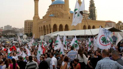 Supporters of the March 14th anti-Syrian opposition coalition take part in a protest a day after the assassination of Internal Security Forces (ISF) intelligence chief General Wissam al-Hassan in Martyrs' Square in downtown Beirut, on October 20, 2012 (AFP Photo / Anwar Amro)