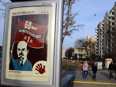 An advertising poster by one of Polish mobile operators featuring a caricature of former Soviet leader Vladimir Lenin is pictured in Warsaw on January 8, 2013. (AFP Photo/Janek Skarzynski)