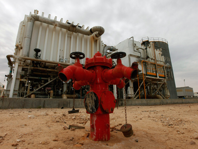 A view of Zawiya oil refinery is pictured in Zawiya 57km (35 miles) west of Tripoli April 11, 2012 (Reuters/Ismail Zitouny)