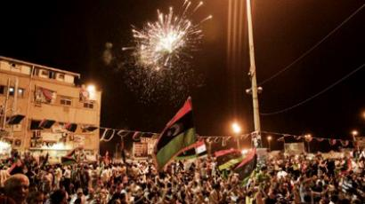 Thousands of Libyans celebrating in the eastern city of Benghazi, as rebels overran Moamer Kadhafi's fortified Bab al-Azizya headquarters in the capital Tripoli after heavy fighting on August 23, 2011, and immediately hoisted their flag to mark the symbolic end to the strongman's 42-year rule (AFP Photo / Gianluigi Guercia)