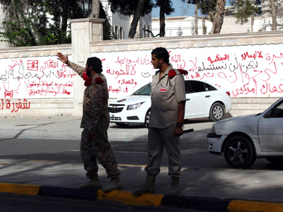 Libyan security members directing traffic outside the walls of the Libyan General National Congress (AFP Photo / Mahmud Turkia)