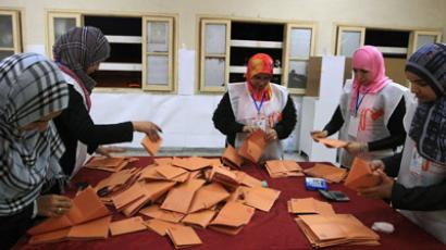Libyan election workers start the counting process at a polling station in the western city of Misrata during Libya's General National Congress election on July 7, 2012. (AFP Photo/Giovanni Diffidenti)