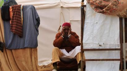 A man sits at at a camp for refugees from Tawargha in Benghazi January 31, 2012.(Reuters / Esam Al-Fetori)