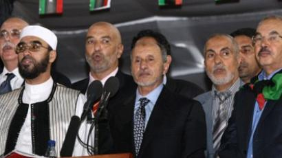 Tripoli : Mustafa Abdul Jalil (C), chairman of the Libyan Transitional Council, is pictured durong his speech at the Martyrs' Square, in Tripoli. (AFP Photo / Mahmud Turkia)