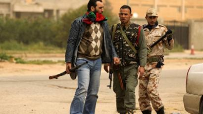 Lybian rebels gathering on the western outskirts of Benghazi on March 13, 2011 (AFP Photo / Patrick Baz)