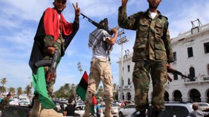 Libyan National Transitional Council (NTC) fighters flash the V-sign for victory during celebrations in the streets of Tripoli following news of Moamer Kadhafi's capture on October 20, 2011 (AFP Photo / Mahmud Turkia)