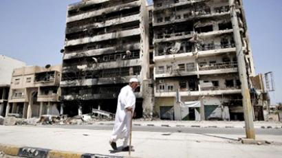 Libya, Misrata: An elderly Libyan man walks past damaged buildings in Tripoli Street in the Libyan port city of Misrata on June 23, 2011. (AFP Photo / Gianluigi Guercia)