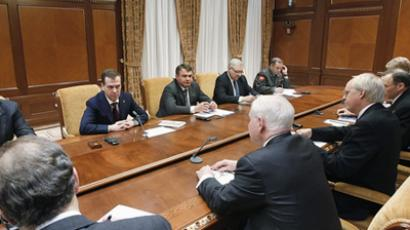 March 22, 2011. Russia's President Dmitry Medvedev (second on the left) talking to U.S. Secretary of Defense Robert Gates (second on the left in the foreground ) during the meeting at Medvedev's Gorky residence.(RIA Novosti / Vladimir Rodionov)