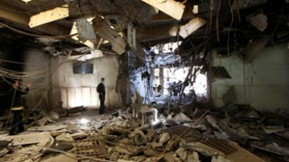 A Libya worker looks at the destruction following the NATO bombardment (AFP Photo / Mahmud Turkia)