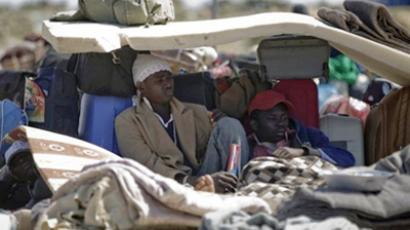 Ghanaians who fled Libya rest at the Choucha transit camp (AFP Photo / Joel Saget)