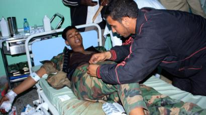 An injured fighter receives treatment at Sabha Hospital after rival militias clashed at the city of Sabha (Reuters / Stringer)