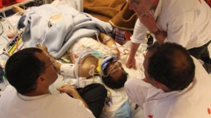 A Handout image released by Medecins Sans Frontieres (MSF) on April 17, 2011 shows medics looking after an injured man, caught in fighting between rebels and forces loyal to Libyan leader Moamer Kadhafi, on board a MedEvac boat heading from the Libyan rebel-held city of Misrata as he and others are evacuated to Zarzis in Tunisia on April 16, 2011 (AFP Photo / Tristan Pfund / MSF)